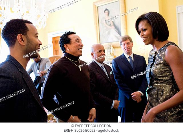 Michelle Obama greets John Legend Smokey Robinson Berry Gordy and Bob Santelli in the White House before the Motown Music Series student workshop. Feb