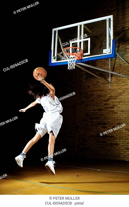 Basketball player aiming at hoop