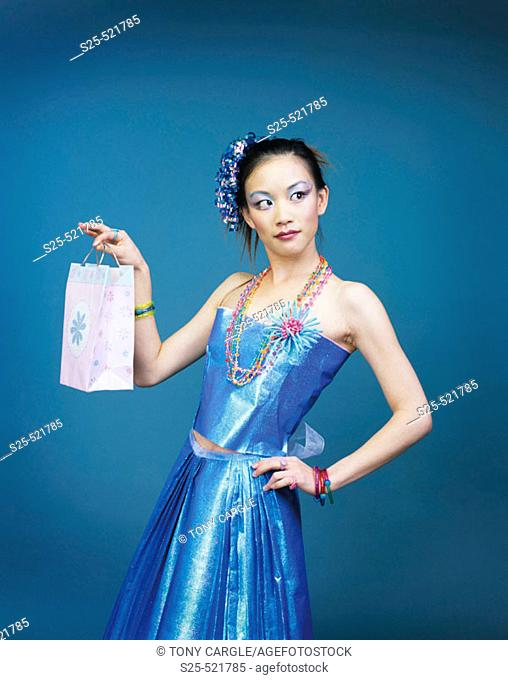 Asian Woman in Skirt & Top made from Wrapping Paper, MR #1056