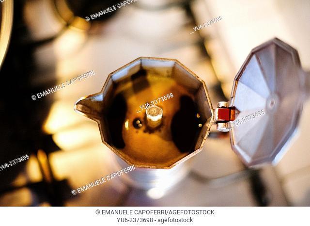 Moka pot full of coffee on the stove