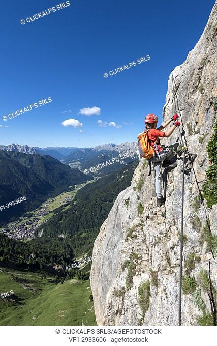 Col Rodella, Dolomites, Trentino, Italy. Climber on the via ferrata to the summit of Col Rodella