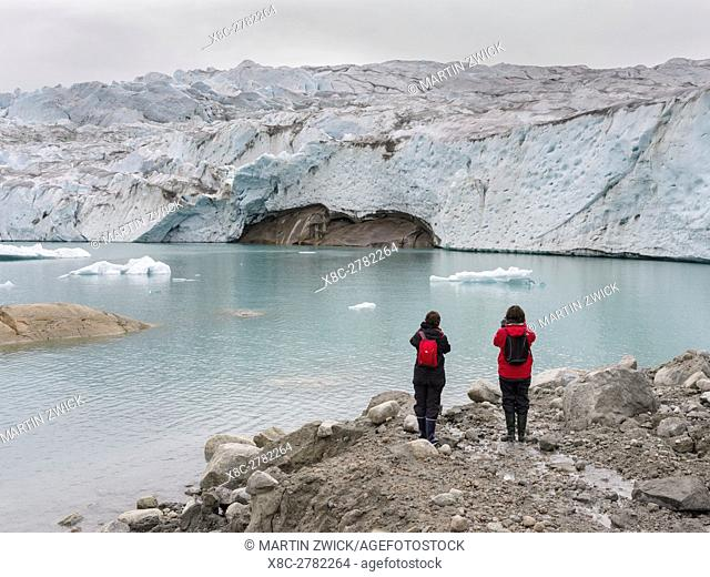 Tourists near the glaciers in the Qalerallit Imaa Fjord in southern greenland. America, North America, Greenland, Denmark