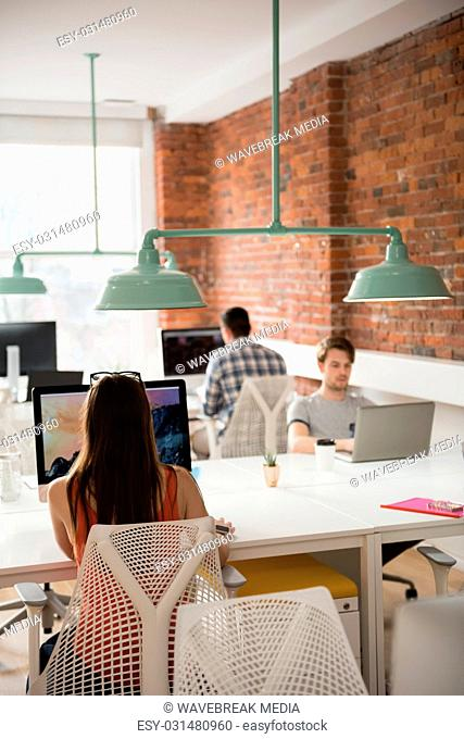 Female executive working on computer in office