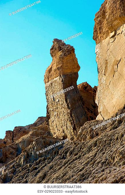 Big rock close to the banks of the dead sea which is called 'Lot's wife'