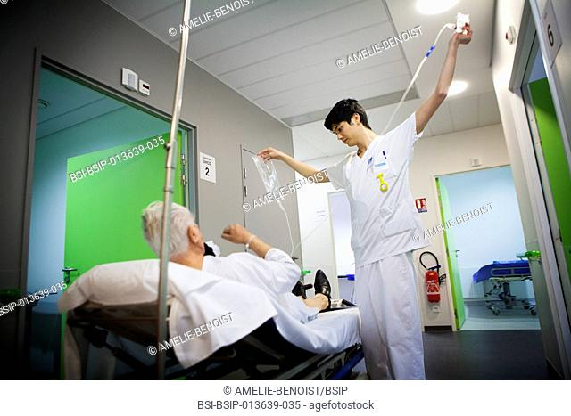 Reportage in A&E at Diaconesses Croix St Simon hospital in Paris, France. A nursing auxiliary looks after a patient