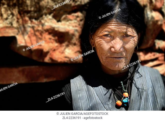Old Tibetan woman at Lori Gompa cave monastery. Nepal, Gandaki, Upper Mustang (near the border with Tibet)