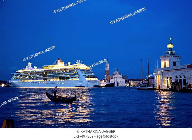 Silhouette of a gondola in front of cruise ship Serenade of the Seas (Royal Caribbean International) passing Isola di San Giorgo