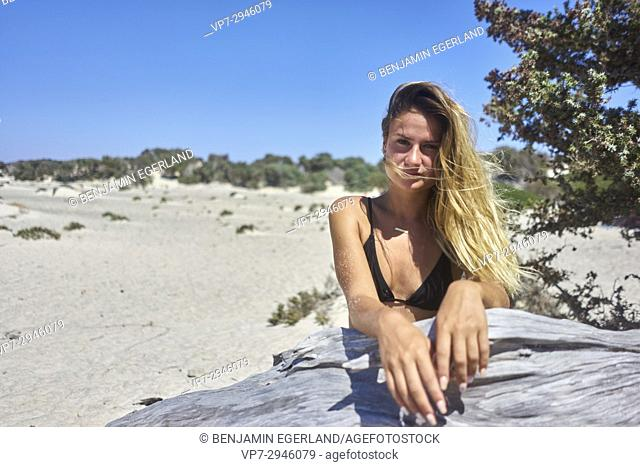 young woman enjoying summer. Dutch ethnicity. At holiday destination Chrissi Island, Crete, Greece