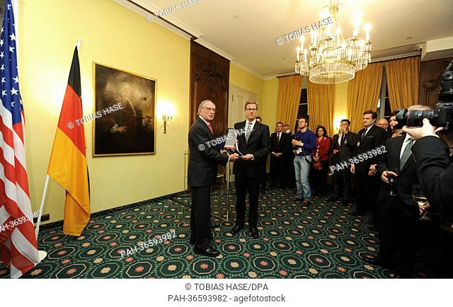 German Foreign Minister Guido Westerwelle (C, FDP) hands the German Federal Cross of Merit to former US senator Sam Nunn (L) on the ifrst day of the 49th Munich...