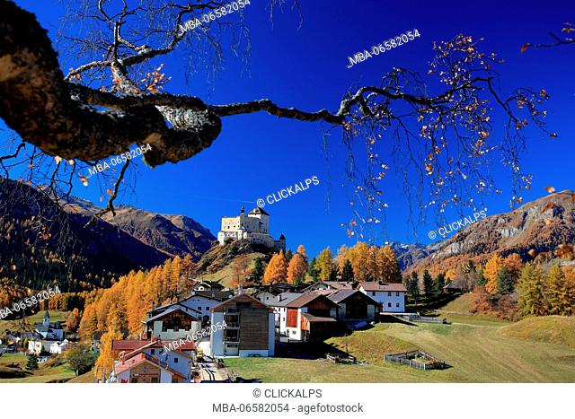 Autumn in Tarasp in low Engadine, with the namesake castle and the beautiful houses Switzerland Europe
