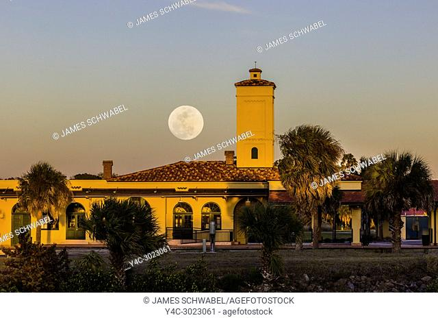 Moon coming up over historic Venice Seaboard Air Line Railway Station also known as the Venice Train Depot in Venice, Florida, United States