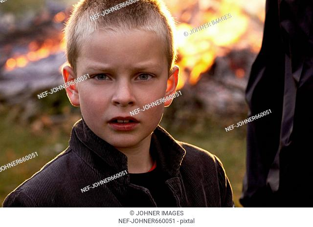 A boy in front of a fire, Denmark