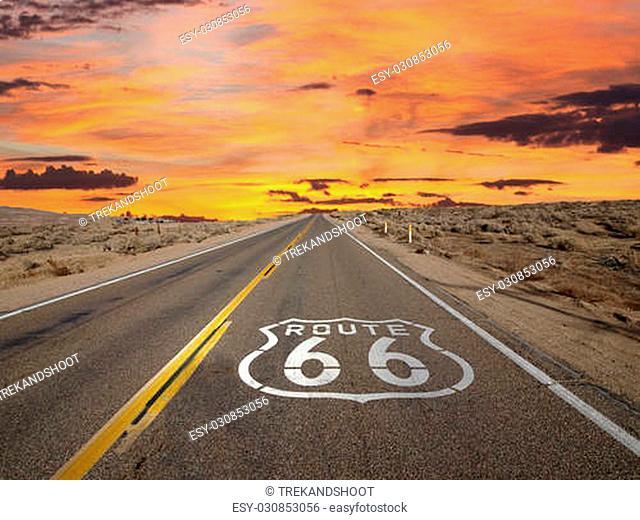 Route 66 pavement sign sunrise in California's Mojave desert