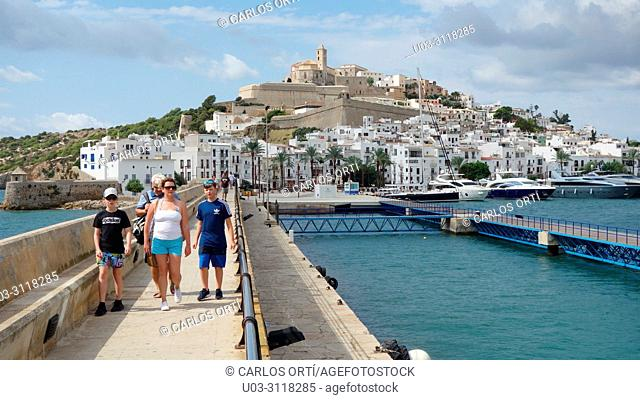 Group of tourists visiting the town of Ibiza. Balearic Islands, Spain, Europe
