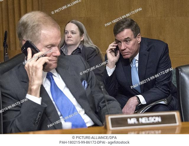 United States Senators Bill Nelson (Democrat of Florida), left, and Mark Warner (Democrat of Virginia), right, speak on their cell phones prior to US Secretary...