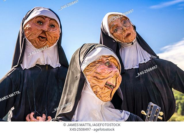 Homemade scarecrows depicting singing nuns at a small town Halloween festival
