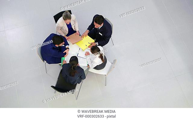 Businesspeople discussing during meeting in office