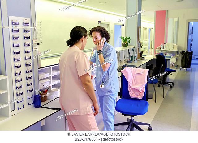 Nurse talking on phone in corridor, Hospital Donostia, San Sebastian, Basque Country, Spain