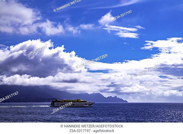 Ocean, ship and mountains seen from Agaeta, Gran Canaria