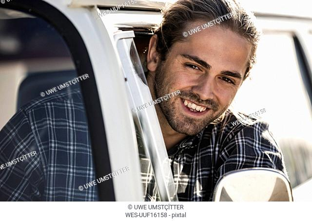 Young man on a road trip with his camper
