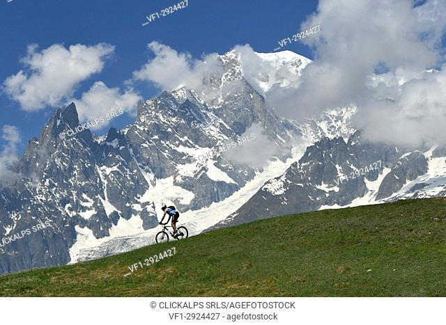 MTB Biker with Monte Bianco (mont Blanc) on background,Val Ferret, Aosta Valley,Italy