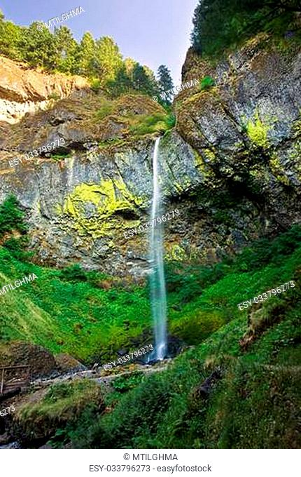 Beautiful Elowah Falls in late afternoon. Elowah Falls is a lush mountain waterfall located on the Oregon side of the Columbia River Gorge