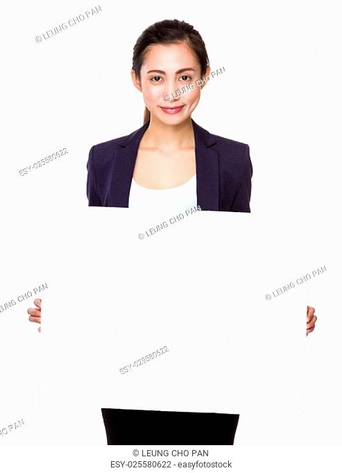 Businesswoman show with white poster