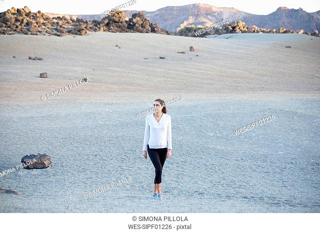 Young woman taking a walk in desert