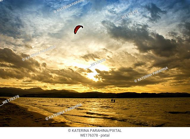 Kitesurfing at sunset time on the river in Laredo, Spain