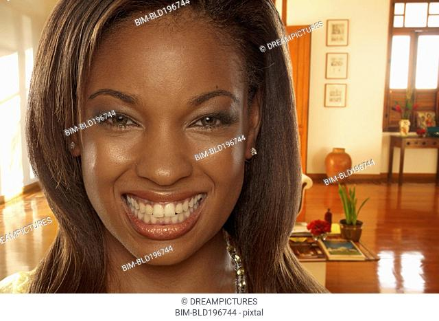 Smiling African American woman in living room