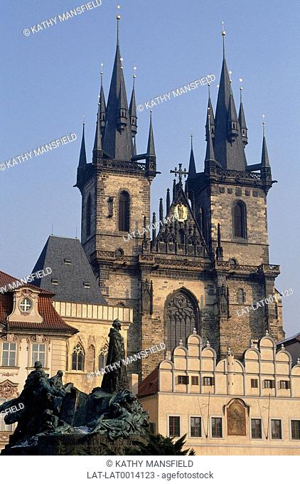 Tyn church towers above buildings of Old Town Square. Monument of Jan Hus in the foreground