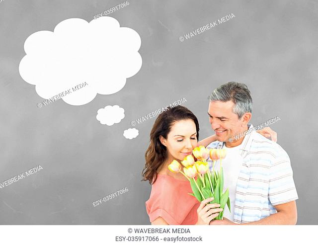 Couple with speech bubble thinking against grey background