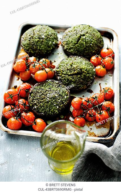 Platter of tomatoes and herbed patties