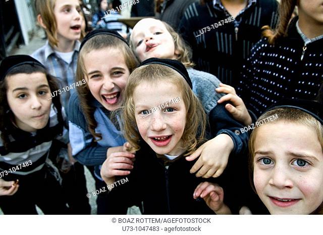Orthodox Jewish children playing in their school