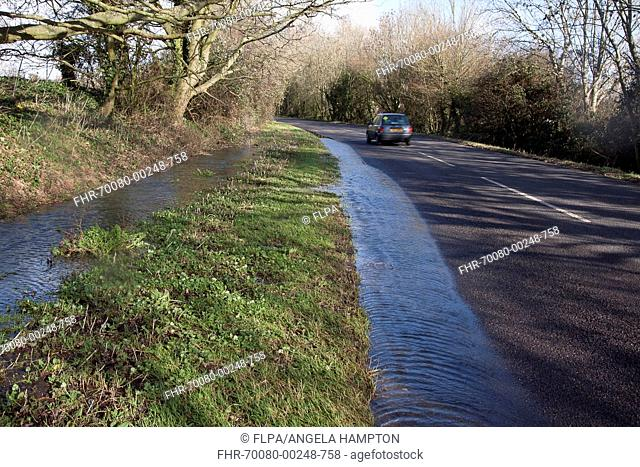 Flooded ditch overflowing into road, Aldingbourne, near Bognor Regis, West Sussex, England, February 2014