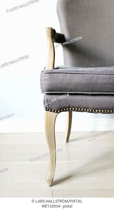 Close up of empty grey chair in home setting