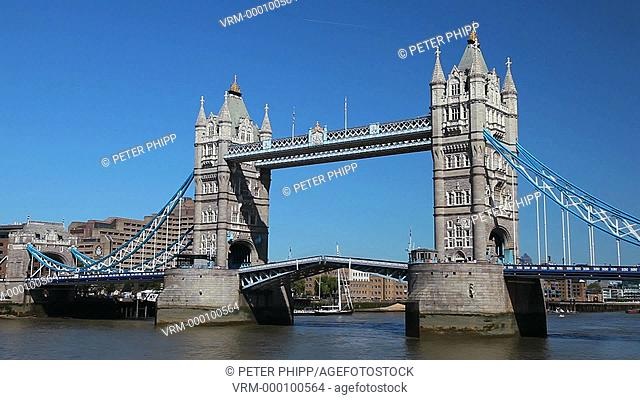 Tower Bridge London opening for tall ship to pass through. This shot is speeded up about 4 times normal