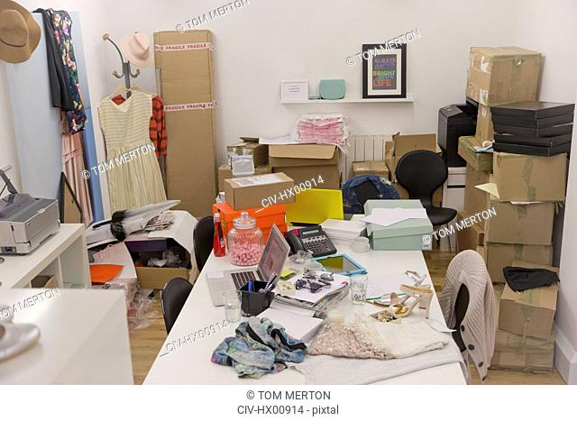 Clothing and boxes in messy fashion buyerís office