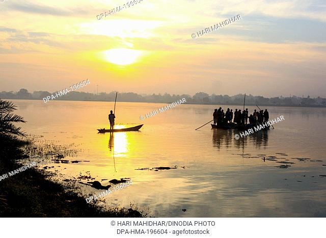 Fishing boat in dalpat sagar lake, jagdalpur, bastar, chhattisgarh, india, asia