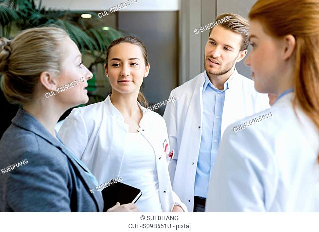 Group of doctors having discussion with consultant