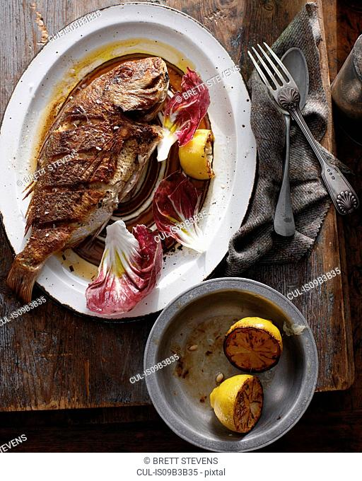 Whole grilled snapper on serving tray
