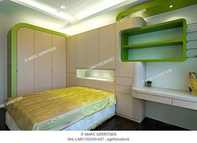 Modern bedroom with greeen accents