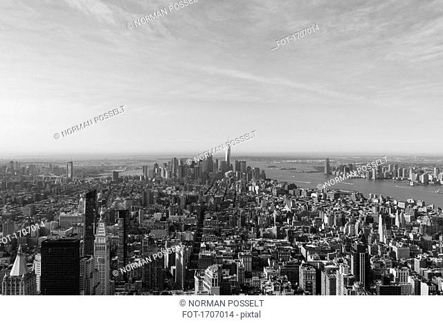 Manhattan by river against sky seen from Empire State Building, New York City, New York, USA