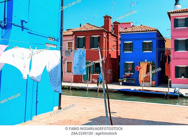Clothesline at blue facade in Burano