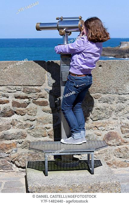 girl and binocular lenses, Saint Malo, Brittany, France