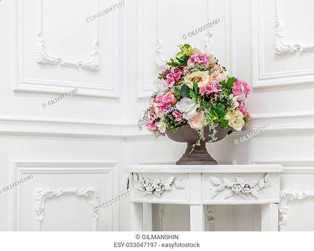 Bouquet of in white interior, horizontal photo