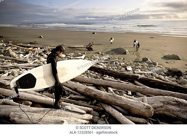 Surfers on the beach at Yakutat, Southeast Alaska; Yakutat, Alaska, United States of America