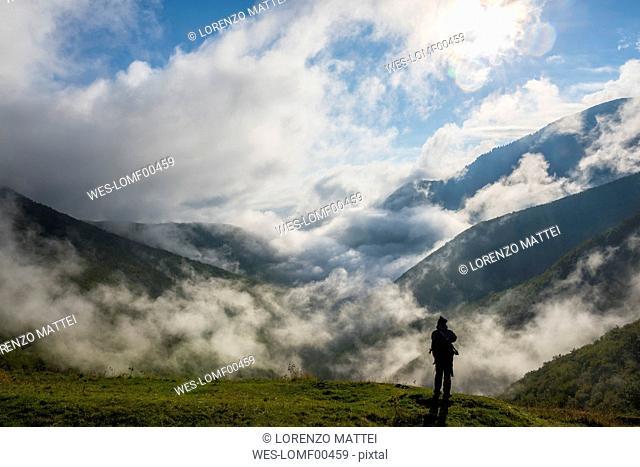 Italy, Umbria, hiker at Monte Cucco Regional Park in autumn