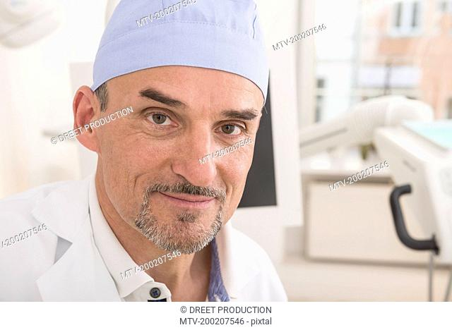 Portrait of dentist wearing surgical cap, Munich, Bavaria, Germany