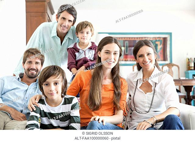 Family together in living room, portrait